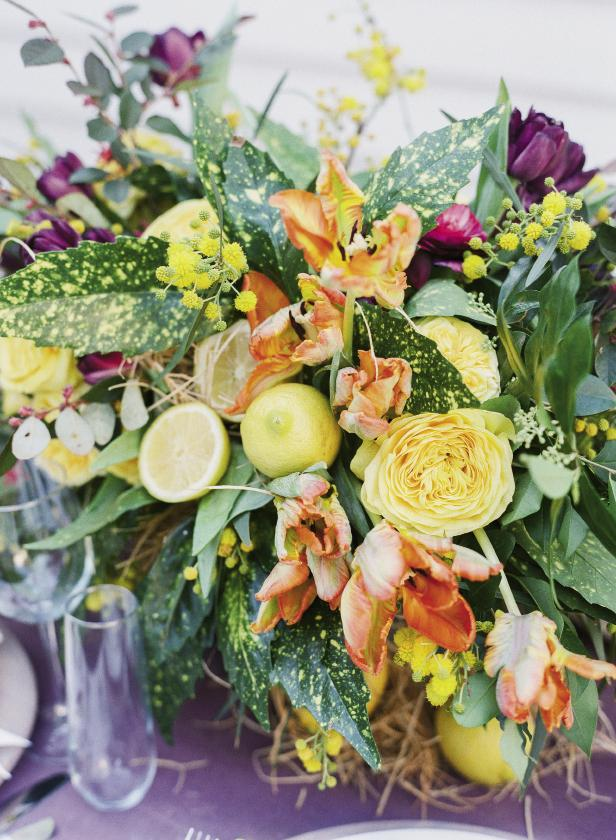 Our favorite floral takeaway from the evening? Incorporating sliced lemons into arrangements. We've seen the whole-fruit version but loved how glistening halves freshened things up. Cut lemons across at middle, then spear with a floral pick and plant in moistened florist foam. Florals by Mindy Rice Floral & Event Design. Photograph by Corbin Gurkin.