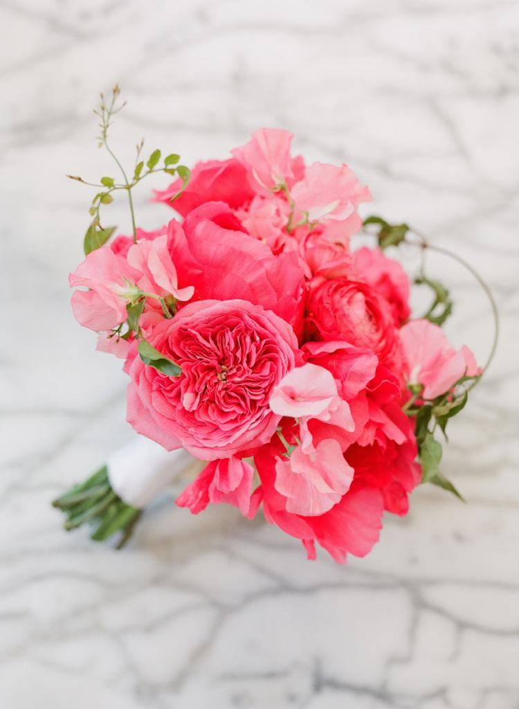 """We wanted the flowers to look like they could have been freshly gathered from a garden,"" says Heather Barrie of Gathering Floral + Event Design of the loose bouquets the wedding party carried."