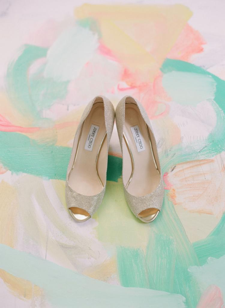 Artist Sally King Benedict (whose work is pictured here with Cate's Jimmy Choo heels) is a family friend of the Morse's and one of the bride's favorite talents. Cate commissioned Sally to craft portraits of each of her attendants and gifted them the abstract pieces.