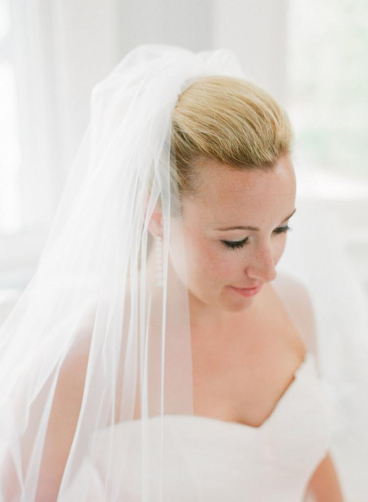 Hair and makeup by Ashley Brook Perryman. Bride's gown by Monique Lhuillier, available in Charleston through Maddison Row. Earrings by Ippolita, available in Charleston through REEDS Jewelers. Bridal styling by Lindsey Nowak and Cacky's Bride + Aid. Photograph by Corbin Gurkin.