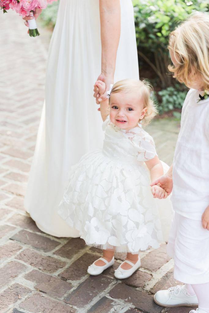 Flower girl's dress by Doloris Petunia. Ring bearer's attire from Southern Belles. Photograph by Corbin Gurkin.