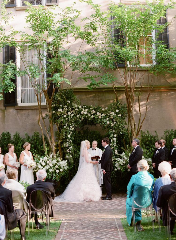 """""""I wanted to get married with guests sitting on the lawn and looking down from the first, second, and third floor piazzas,"""" says Cate. """"The anticipation of having the wrought-iron gates open, walking down to Hugh and looking up and around at our friends and family was the most exciting moment I could possibly imagine. In reality, it was even more special."""""""