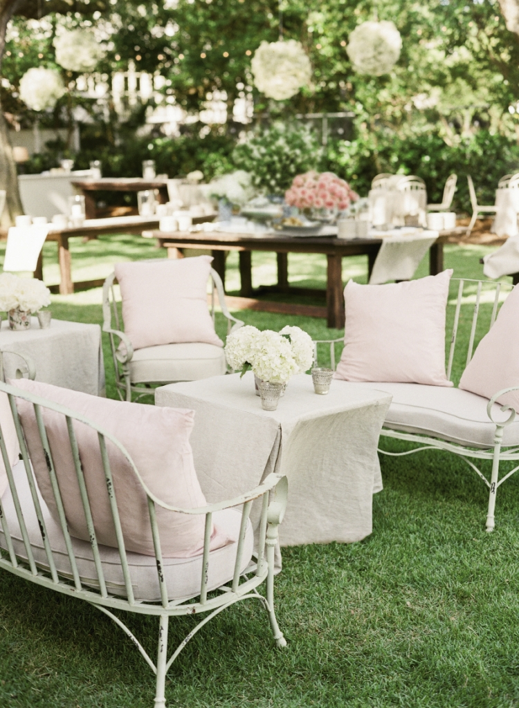 French-style wrought iron furniture with linen cushions 
