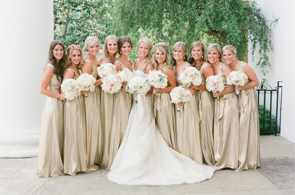 Photograph by Corbin Gurkin. Bride's attire by Vera Wang. Bridesmaids' attire by Kate McDonald, available in Charleston through Kate McDonald Bridal. Bouqets by Tara Guerard Soiree.