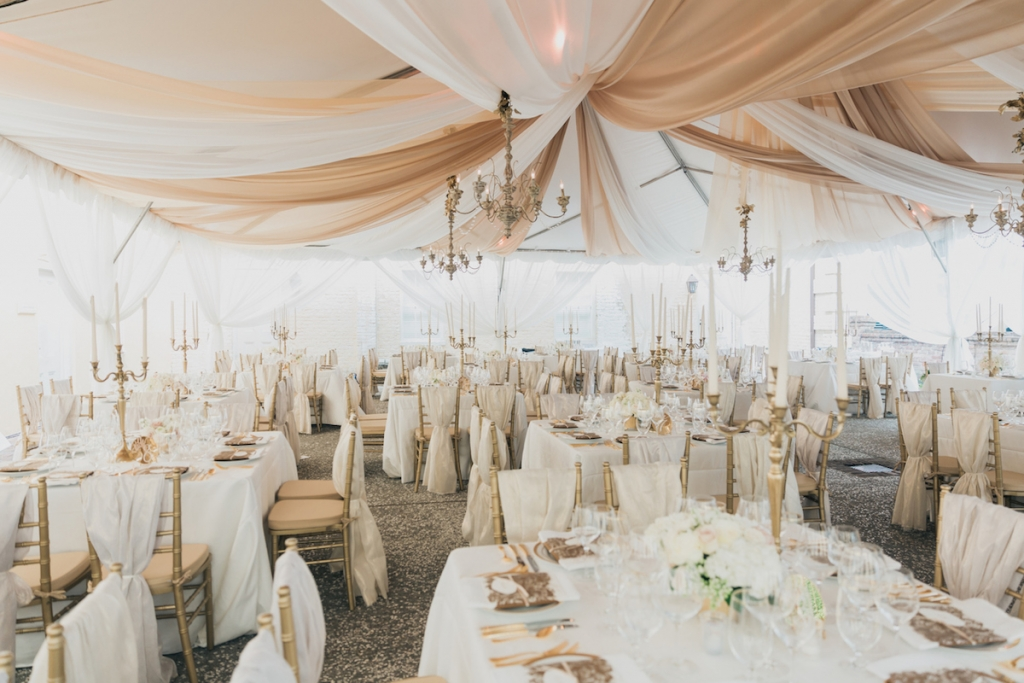 Photograph by Corbin Gurkin. Tent and rentals by Snyder Event Rentals. Design by Tara Guerard Soiree. Lighting by Production Design Associates.