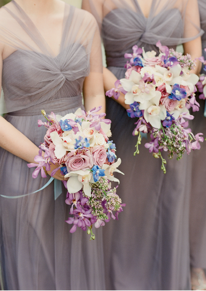 """We've seen a shift from tightly packed  handheld florals to loose, more organic arrays,"" Tara  explains of the cascading bridesmaid bouquets. (Photo by Corbin Gurkin)"