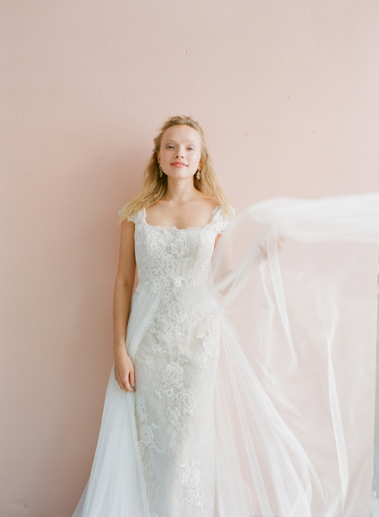 "Pronovias' ""Oasis"" mermaid gown from Gown Boutique of Charleston. BOUNKIT's amethyst and aquamarine earrings from Gwynn's of Mount Pleasant. <i>Photograph by Corbin Gurkin</i>"
