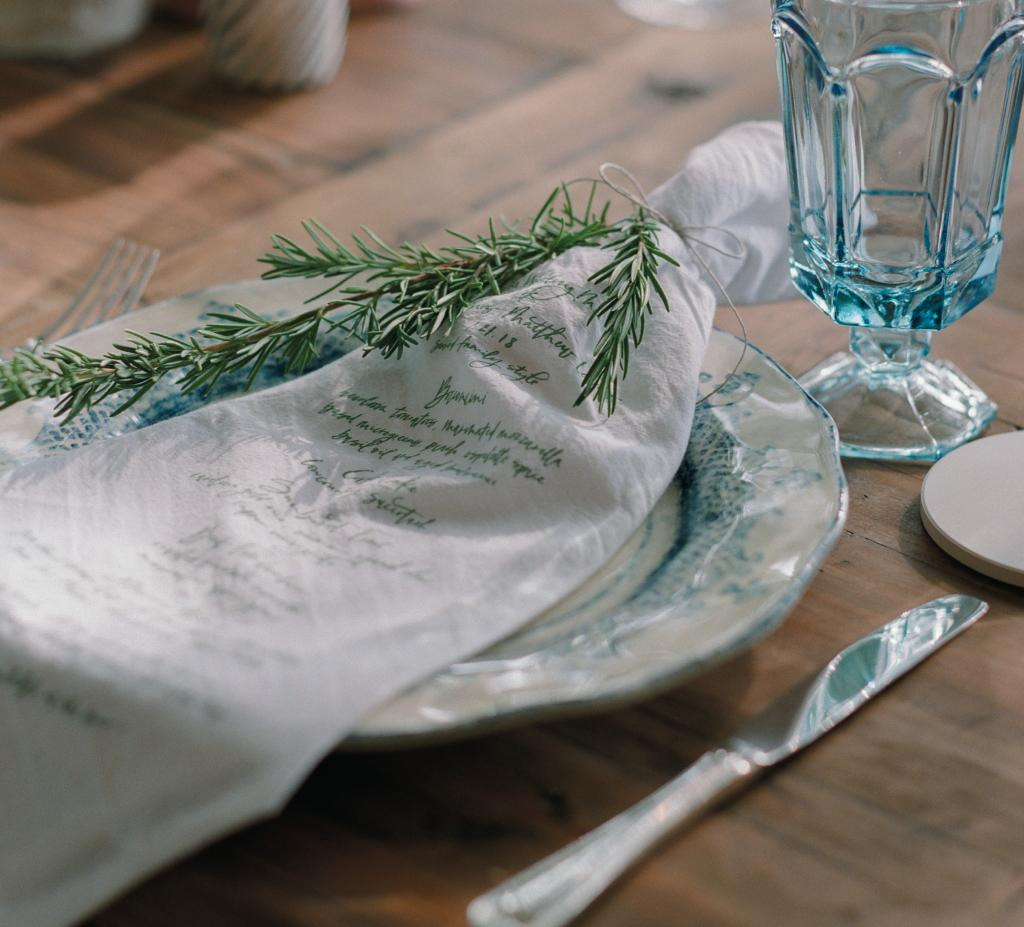 Printing a menu on the table linens? Genius, Lettered Olive!