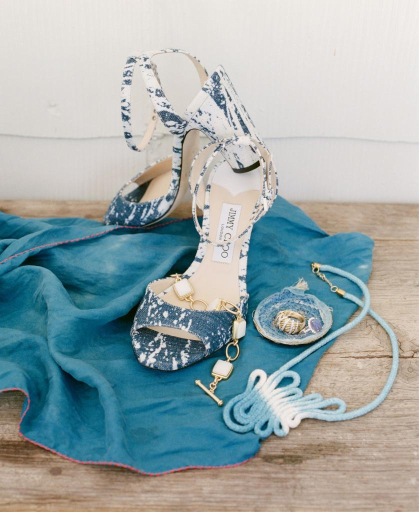 "Jimmy Choo's ""Miranda"" sandals from Gwynn's of Mount Pleasant. Madame Magar's coiled, hand-dyed indigo fabric ring dish and silk scarf, both from the Gibbes Museum of Art gift shop. Black opal and diamond gold ring from Gold Creations. David Yurman's Helena  Collection gold dome ring from REEDS Jewelers. ""Jane"" toggle bracelet from Spartina 449. ""Robin's Egg"" hand-dyed and hand-sewn indigo rope necklace from Kristy Bishop"