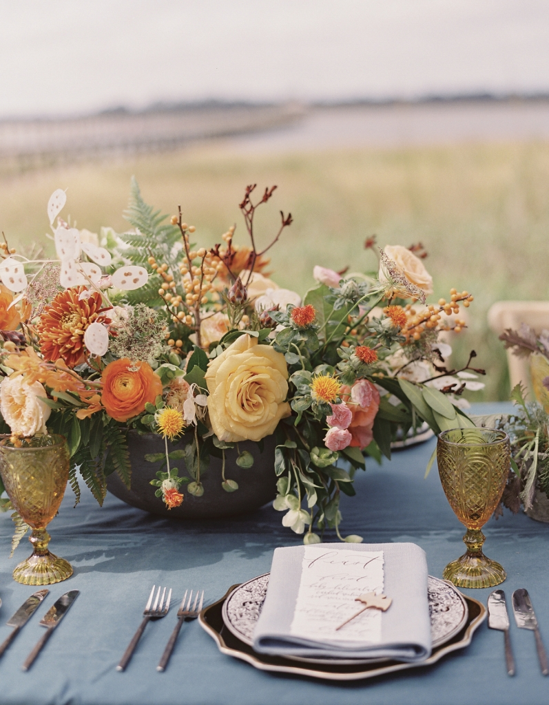 Elegant autumnal floral centerpieces by Vero Designs echoed the fall hues of the marsh grass along the Ashley River, an element of refinement that still lets the drama of the setting take center stage.
