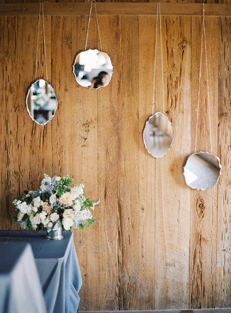 SCATTER SHOT: Hanging mirors in clusters helped to reflect light for a romantic—and functional—effect.