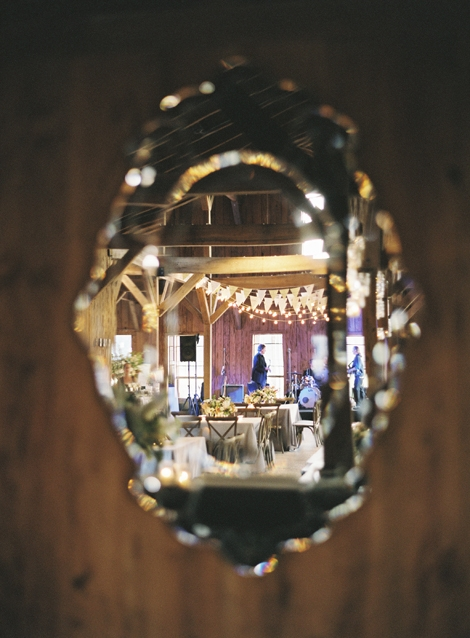 MIRROR BALL: Venetian-style cut-glass mirrors added polish to the rustic barn walls.