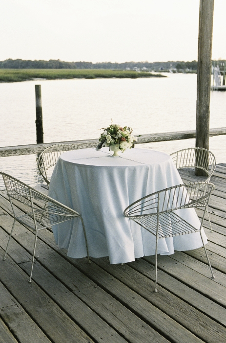 DOCK SITTIN': Wire garden chairs provided seating for guests to take in views of Wampacheone Creek.