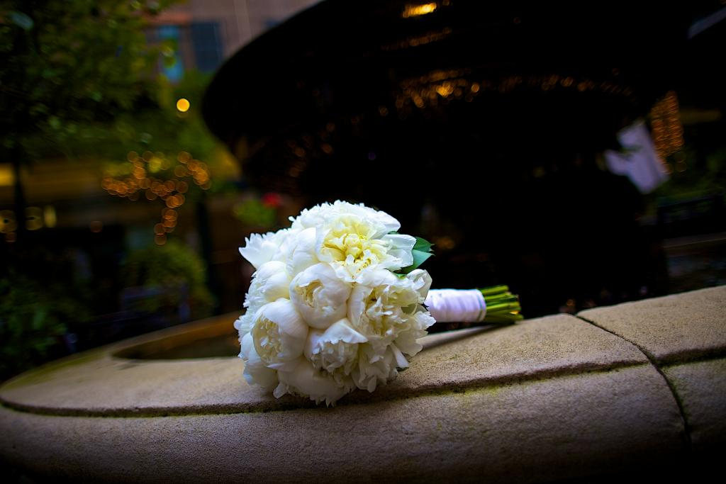 FRAGRANT BUNCH: The bride carried a lush bouquet of white peonies.