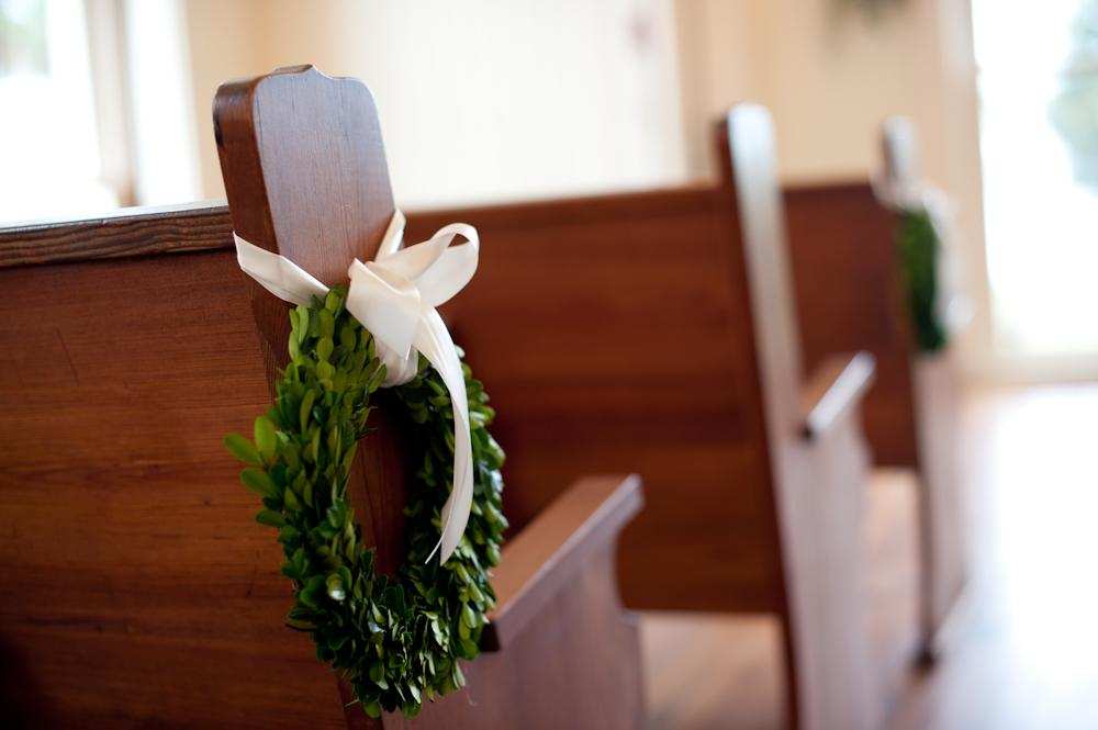 EASY DOES IT: For ceremony décor, Sue fashioned wreaths from boxwood leaves.