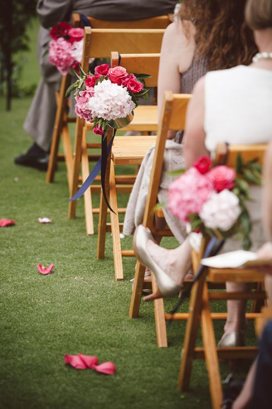PALETTE PLAY: Gathering Floral Event + Design tied floral bundles to chairs with navy ribbon to create aisle markers.