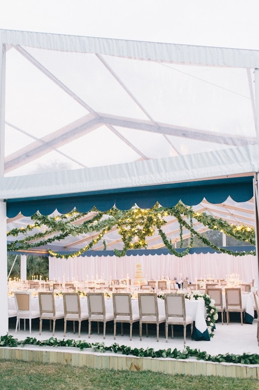 Kelly asked Tara to create a simple yet romantic setting with chandeliers and multi-sized tables.