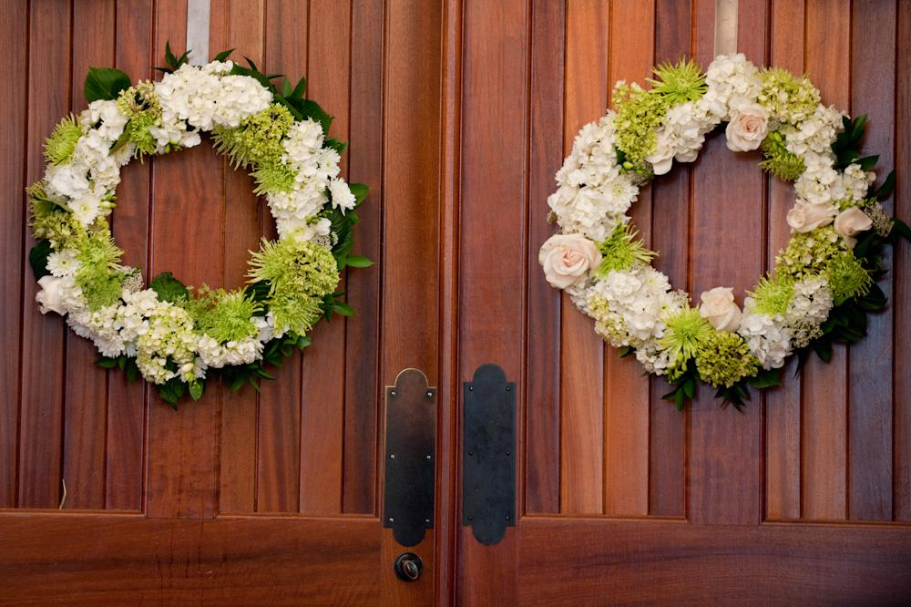 "WARM WELCOME: ""I wanted to keep the flowers simple and elegant,"" says Jacki. ""We chose a color palette of whites, creams, and greens and selected season flowers."""