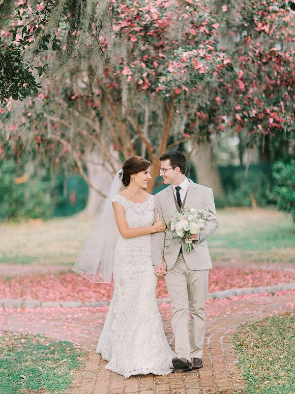 Bridal gown by Allure Bridals, available in Charleston through Bridals by Jodi. Groom's suit from Express. Groom's vest from J.Crew. Bouquet by Branch Design Studio. Image by Amy Arrington Photography at Old Wide Awake Plantation.
