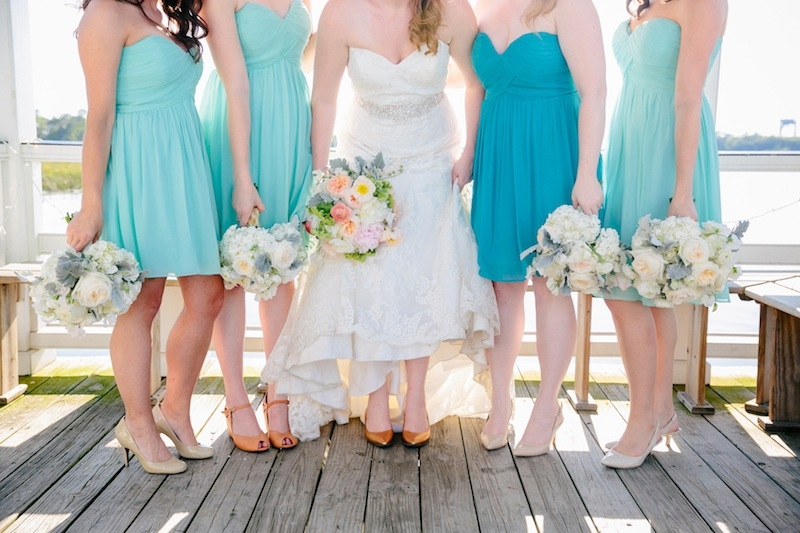 Bridesmaid attire by Donna Morgan through Bella Bridesmaids. Bride's gown by Mori Lee through Jean's Bridal. Florals by Branch Design Studio. Image by Dana Cubbage Weddings.