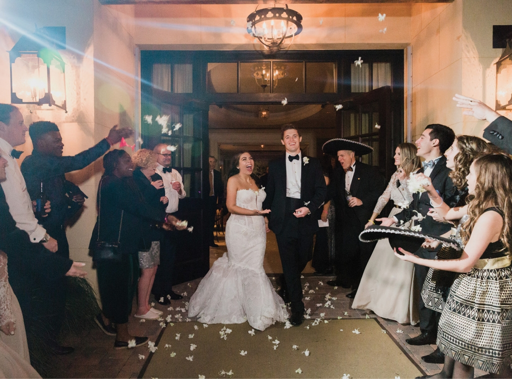 """There was so much love in the air,"" Gaby says of the night. A few guests borrowed the Mariachi band's sombreros when they lined up to shower the couple in orchids during their departure.  <i>Photograph by Corbin Gurkin</i>"