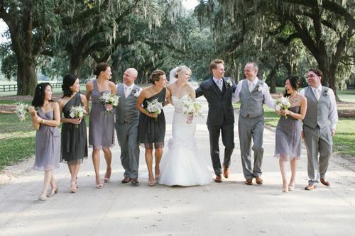 """LEAN ON ME: """"I knew I didn't want the girls in identical dresses,"""" says Abby of choosing bridesmaid frocks in three different styles and shades of grey from Amsale."""