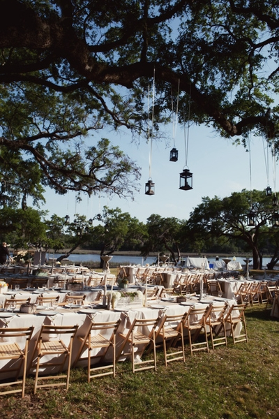 CREEKSIDE CHARM: The marsh, creek, and Wadmalaw Sound in the distance made a picturesque backdrop for the reception dinner underneath the live oaks.