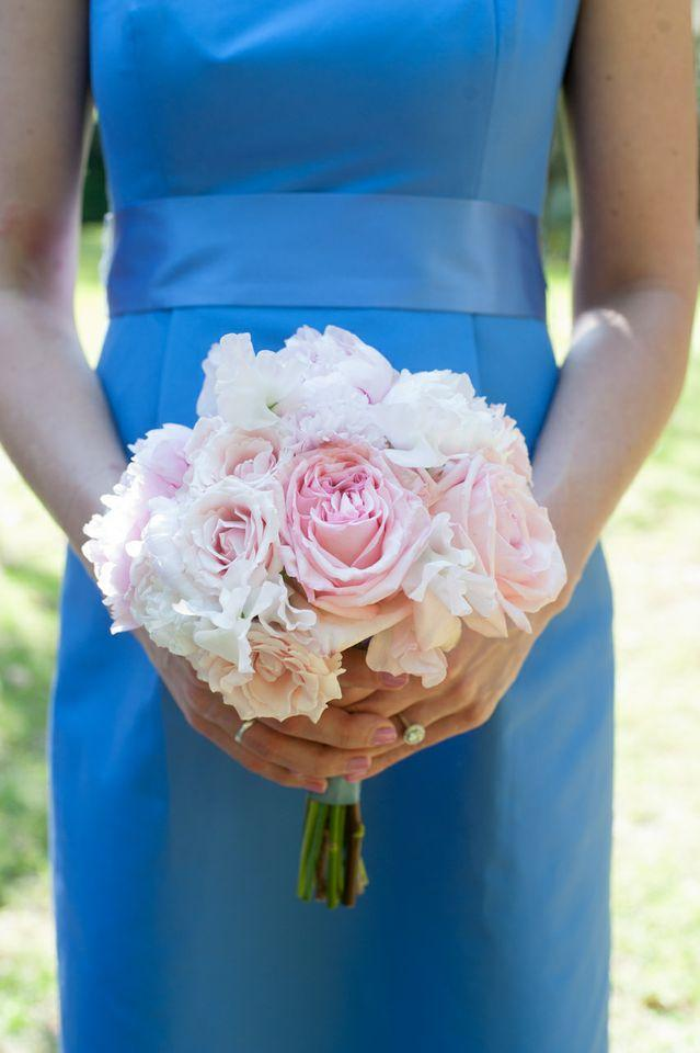 "COLORFUL CONTRAST: Pink peonies stood out against the bridesmaid's J.Crew frocks. Of the wedding's color palette D'Anne says, ""I wanted something soft and romantic, yet a bit unpredictable."""