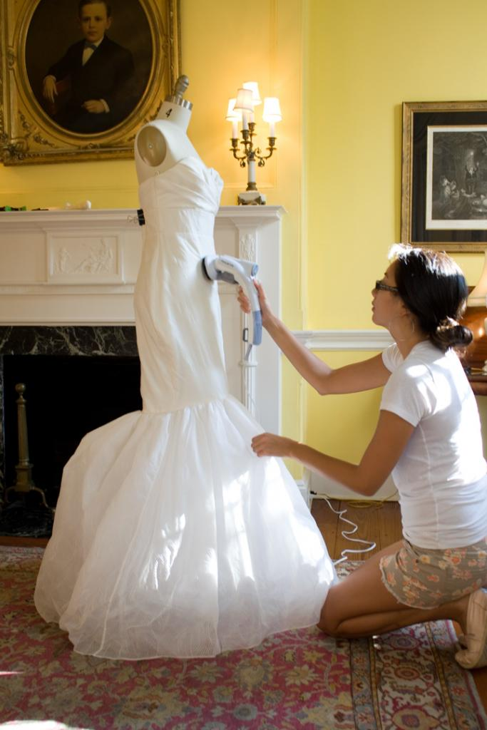 "Kristy steams LulaKate's ""Novak"" gown smooth. The cover of the 2008 Charleston Weddings was shot in this room"