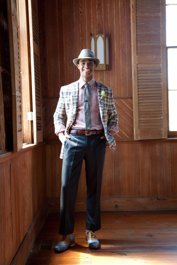 DAPPER DAN: Fitzgerald-fit madras sports coat, navy wool garbadine trousers, and argyle Egyptian cotton  socks, all from Brooks  Brothers. Canali's plaid oxford, Bill Lavin Soft Collection's snakeskin belt, and Cole Haan shoes, all from Gwynn's of Mt. Pleasant. The Hill-side's tie from Indigo and Cotton. Fedora and vintage tie clip, both from Billy Reid. OMEGA's Seamaster Aqua Terra watch in 18K rose gold and stainless steel from Kiawah Fine Jewelry.