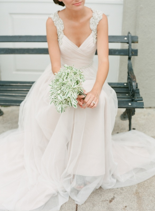 """Hayley Paige's """"Houston"""" pink netting gown with alabaster embellishments from White on Daniel Island. Rhinestone bracelet from Jean's Bridal. White gold and diamond ring from Croghan's Jewel Box. Bouquet from Tiger Lily Weddings. Image by Corbin Gurkin, photographed at The Vendue."""