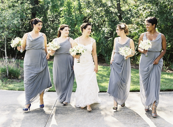 LOVELY LADIES: Bridesmaids wore Dessy gowns in charcoal gray.