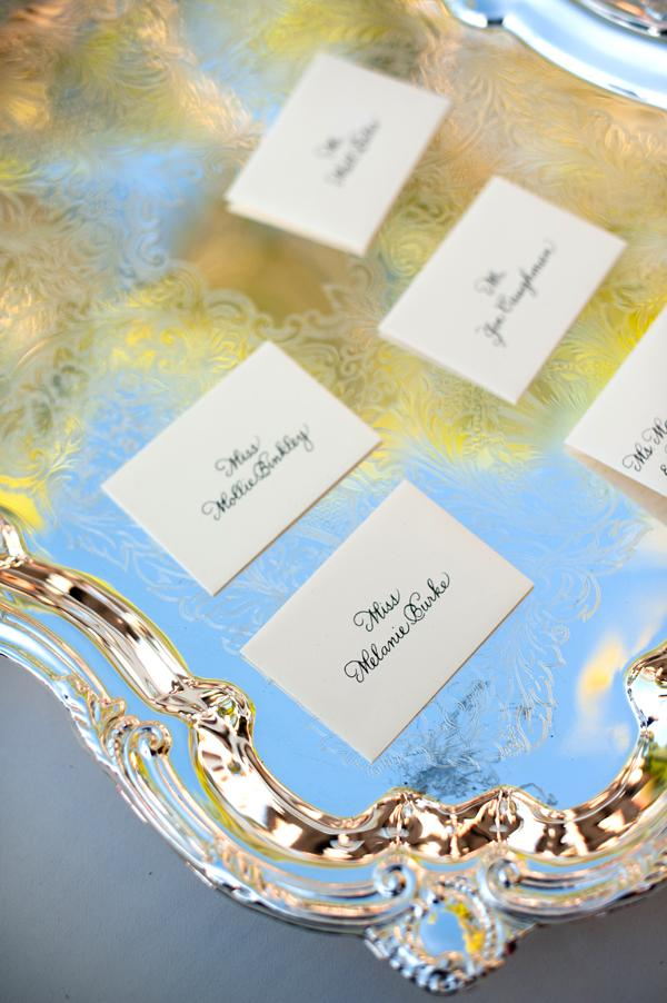 A FORMAL AFFAIR: Place cards rested atop antique silver trays.