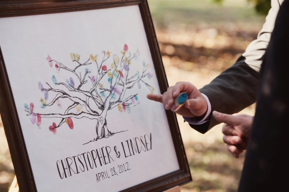 TREE OF LIFE: In lieu of a traditional guestbook, the nature-loving duo had family and friends stamp their fingerprints and names on a customized tree canvas.