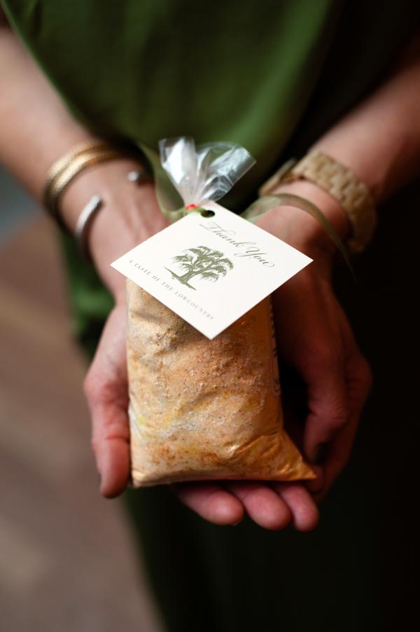 GIVING THANKS: Guests took home a bag of grits, each with a note from the happy couple (which Anna attached herself).