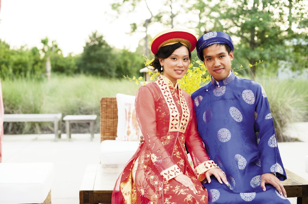 PAST PRESENT: Linda and Vu changed from modern wedding wear into traditional Vietnamese áo dài garments in vivid silks.