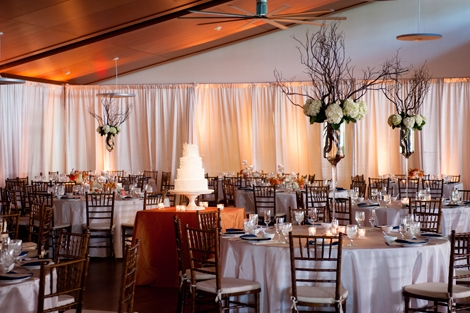 FLORAL NOTES: Tall, branch-filled arrangements accented with white hydrangeas filled the airy reception space.