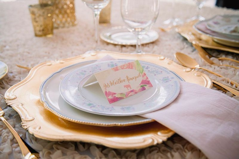 Mixed table settings paid homage to Amanda's grandparents, who never match their china. The elder pair picks out a new piece whenever they visit a special place together, and the younger couple vows to follow suit.