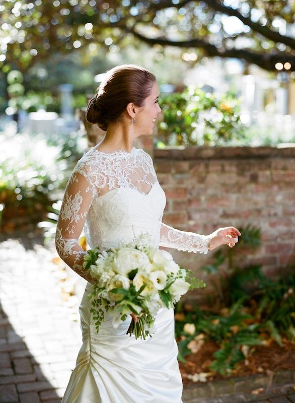 Bridal attire by Monique Lhuillier, available in Charleston through Maddison Row. Hair by Stuart Lawrence Salon. Bouquet by Sara York Grimshaw Designs. Image by Marni Rothschild Pictures.