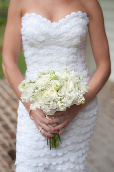 TO HAVE AND TO HOLD: Florist Sue Burton mixed white parrot tulips with Baby's Breath and other seasonal blooms.