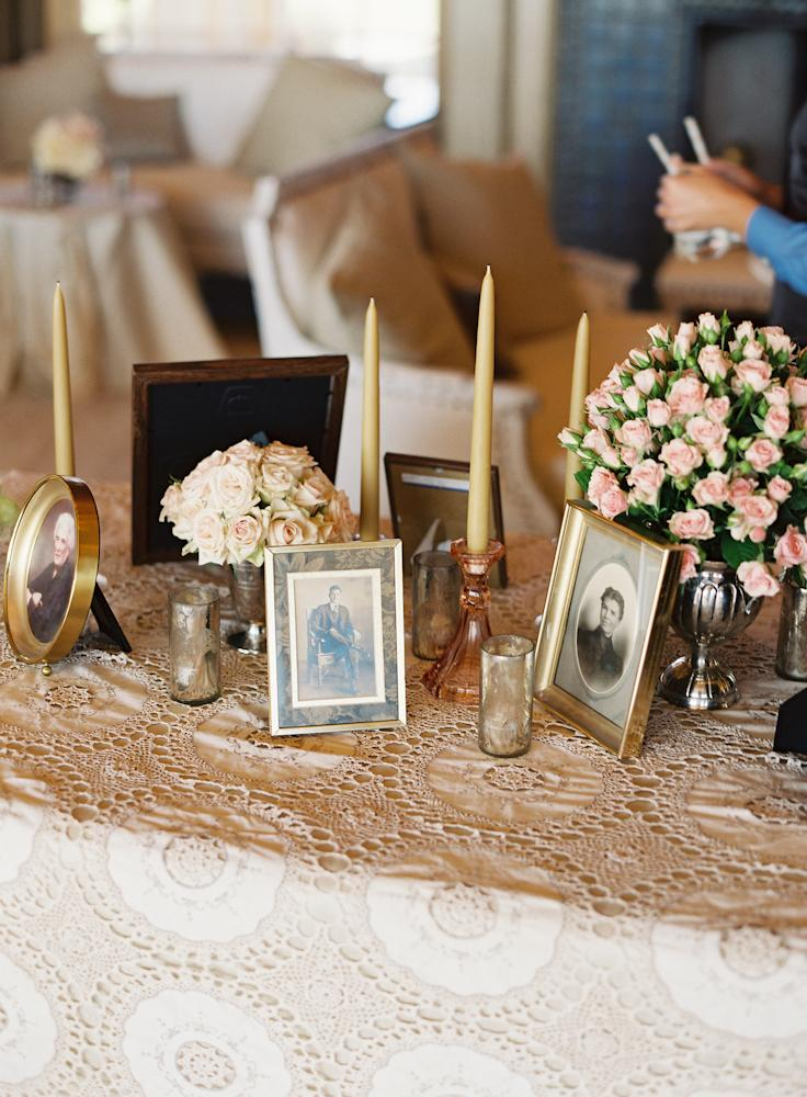 IT'S ALL RELATIVE: For a personal touch, Crystal assembled old family photos to mix in with the taper candles and bunches of roses.