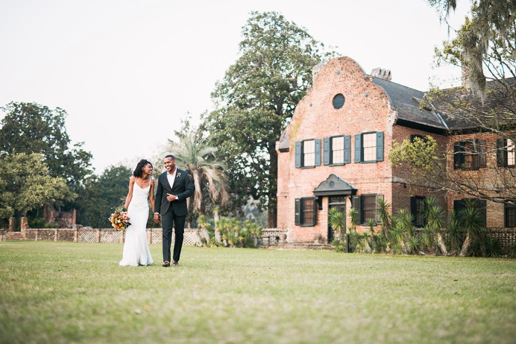 Real-life couple Venita Aspen and Alex Saunders exude chemistry, not to mention style. Their understated looks—her sheath gown and his open-collar shirt and suit—epitomize the easy elegance of smaller weddings at staid locations.