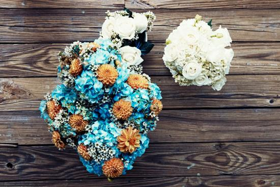CAST OF COLORS: Lisa arranged an all-white bridal bouquet and bridesmaid bunches of blue hydrangea, cream-colored wax flowers, and orange dahlias.