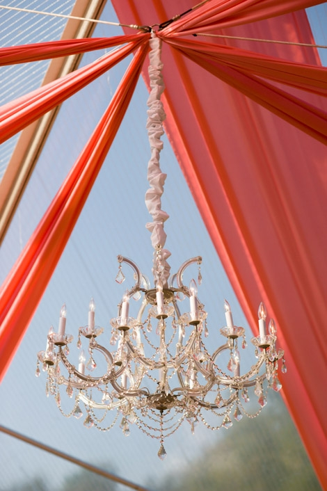 ABOVE AND BEYOND: Panels of coral fabric added color to the dance floor's clear-top tent, while a crystal chandelier provided an oh-so-elegant finishing touch.