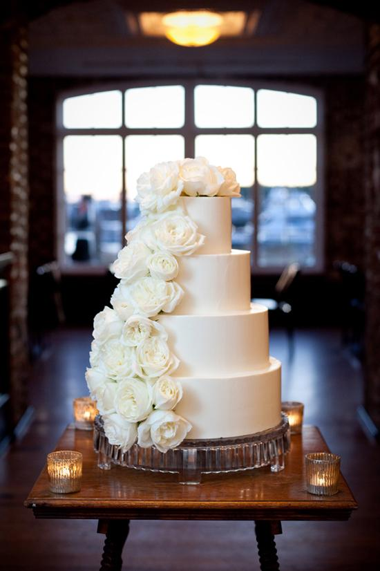 TWO-FACED: The four-tiered cake by The Cake Stand featured one side of smooth white icing, and another of cascading roses.
