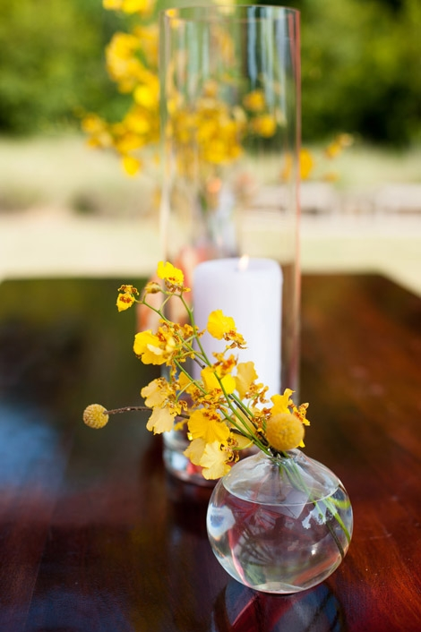BEST BUDS: Petite drop vases holding yellow orchids added golden touches to reception florals.