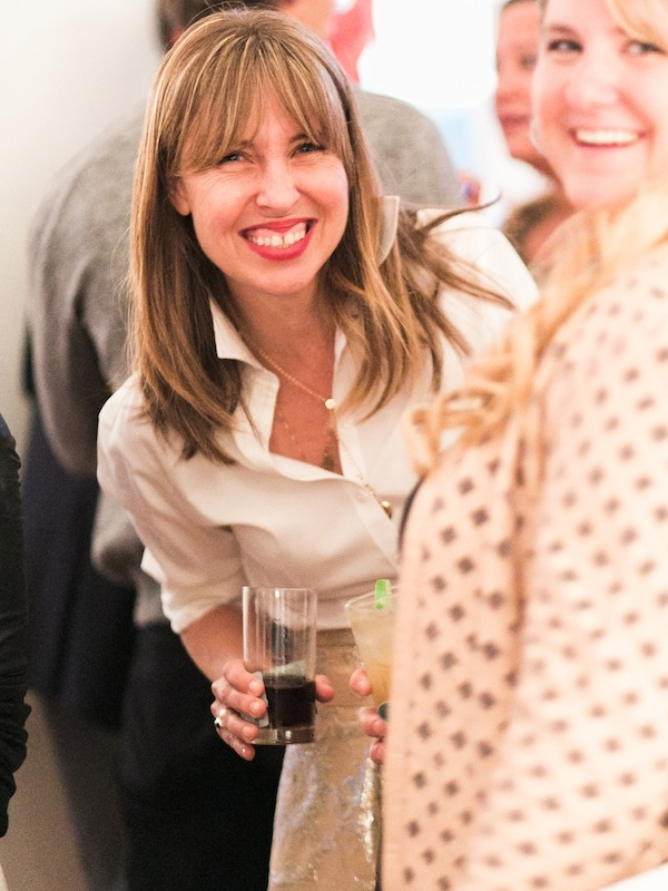 Melissa Bigner gets a more than a little goofy with frequent contributor, photographer Corbin Gurkin. The goal of the night? A casual gathering with market and magazine pals to kick off the week with an easy-going Charleston fete.