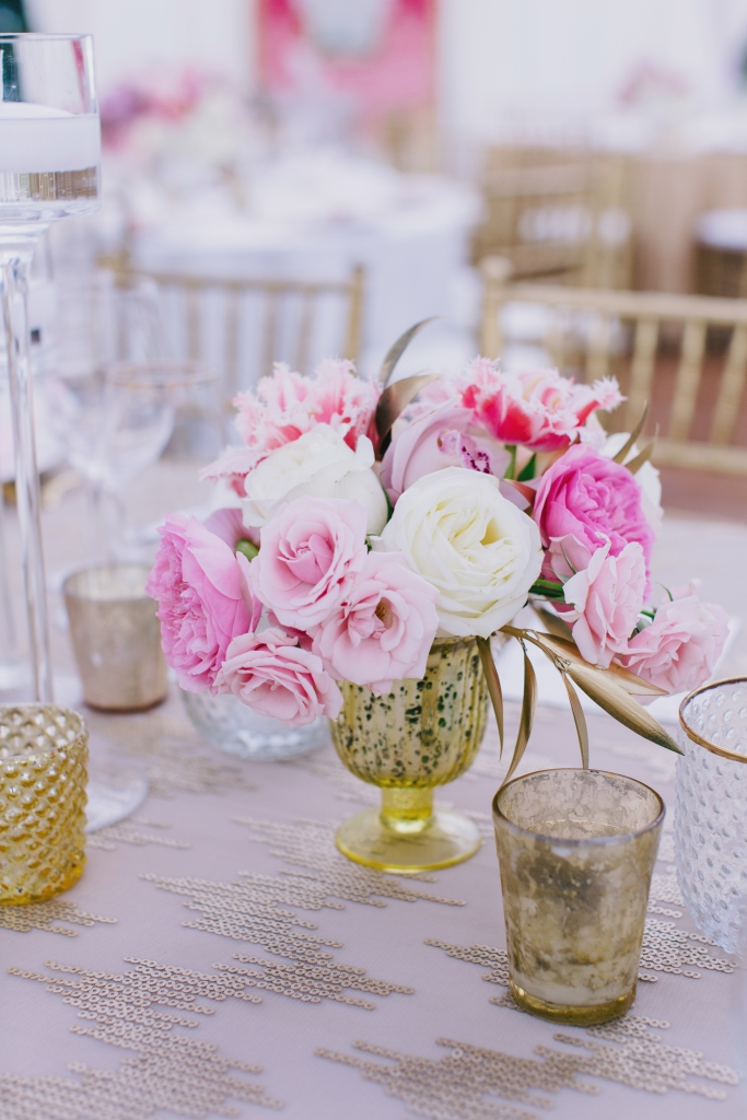 Chalice-shaped vases overflowed with roses, tulips, and orchids in shades ranging from blush to magenta. <i>Photograph by Hyer Images</i>