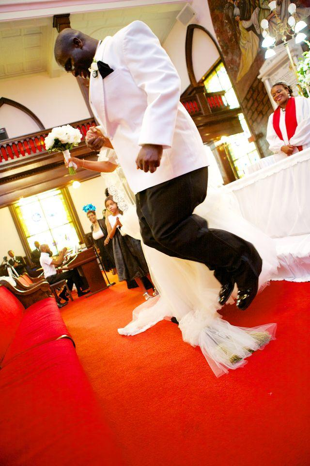 """STEP BY STEP: In addition to jumping the broom, the ceremony included the tying of """"God's Knot,"""" meant to symbolize the joining of man, woman, and Christ. Of the spiritual touch Richelle says, """"Both of us come from Christian backgrounds, so it was important to not only celebrate our love, but to acknowledge that God was responsible for the day and our union."""""""