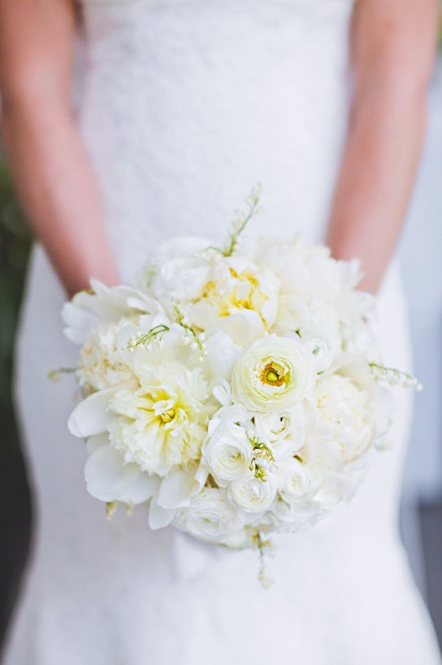 PALE PRETTIES: White peonies, roses, ranunculus, and Lily of the Valley filled the bridal bouquet.